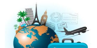 Чемодан с земным шарам и атрибутами для путешествий